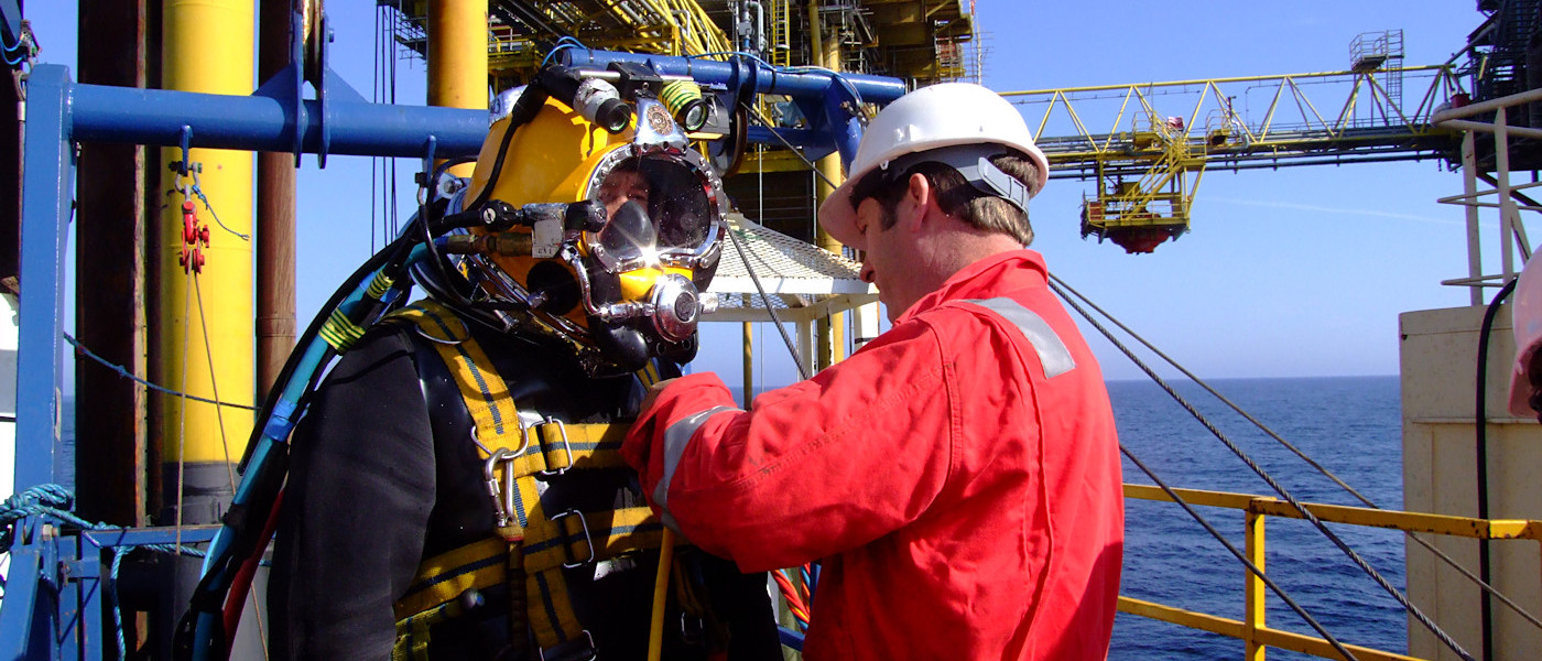 Diver being prepared to dive from a rig