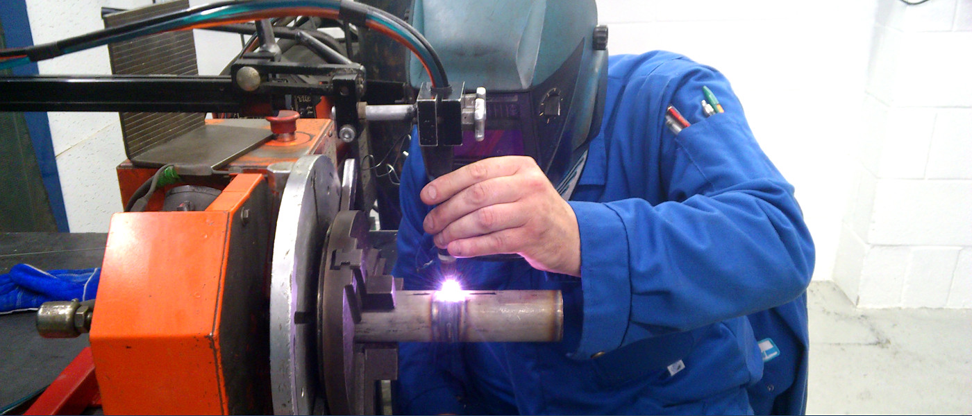 Welding a pipe on a lathe
