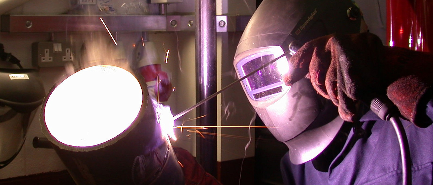 A weldr welding a large pipe