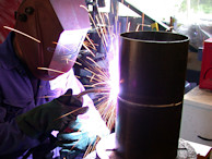 Image of a vertical pipe being welded