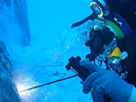 Image of a diver welding underwater